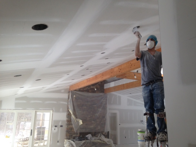Drywall being applied by DiCarlo Construction Services