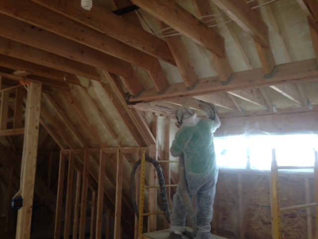 Spray foam insulation being applied in a home